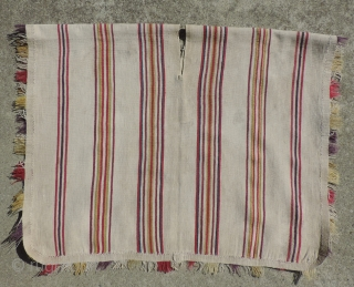 Rare White Ground Aymara Ponchito (small poncho).  Altiplano region, Bolivia.  Early 19th Century or before.  One of a kind cotton and alpaca man's ceremonial overgarment.  Size: 30 x  ...