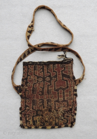 Pre-Columbian bag with strap. The curious design of this bag has both zoomorphic and anthropomorphic features and a color palette that is not common. The bag dates to A.D. 1000 - 1400.  ...