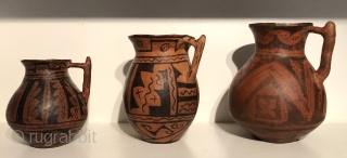 Three pre-Incan black on red pitcher shaped ceramic vessels. A.D 900 - 1400.  From Altiplano region of Bolivia and showing Tiawnaku influence.  These ceramics are sometimes referred to as Expansive  ...