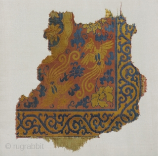Yuan Dynasty or Early Ming Textile Fragment.  c. 1300 - 1450 AD. 13 x 14 inches.  Great color and imagery, nicely mounted to larger frame.  Very nice.