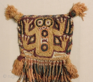 Super cool little Pre-Columbian textile.  This rare, graphic piece was made as tassel or pendant.  The image is that of a frog which is associated with water and fertility. Some  ...