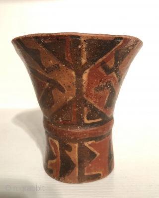 Ancient Andean drinking vessel known as a hero. A.D 800 - 1100.  Ceramic cups in this flared shape were made for the consumption of  alcoholic beverages during ritual occasions.   ...