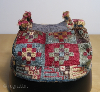 Of all the Wari pile hats I've had over the years this simple stepped diamond designed example remains among my personal favorites. This textile is all about the color and the fiber.  ...