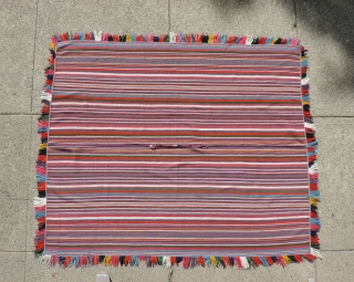 Blazing multicolored stripes in a 19th century Aymara poncho from the Southern Altiplano region of Bolivia.  Like Joseph's cloak of many colors from the Bible, this example has colors that are  ...