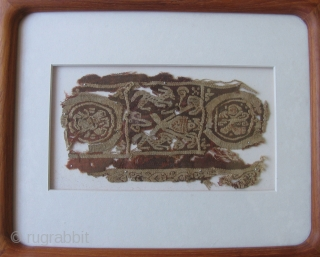 Coptic Tapestry Fragment,  Mounted behind plexi.  3.5 x 7 inches, frame size 9 x 11 inches.