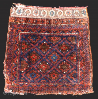 Baluch stars and lattice designed bag face.  Interesting flat woven top section. Some silk highlights.  Good wool and color.