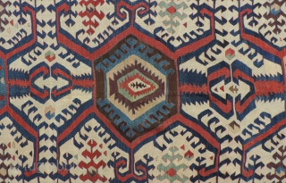 White Ground Anatolian Kilim.  The strong animated design of this old Hotamis kilim is explosive, but well balanced.  There are areas on both selvedges that are intact indicating the piece's  ...