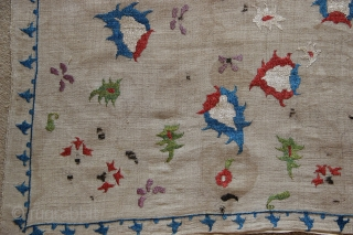 17th century Ottoman bocha. The surviving embroidery is in excellent condition, only the black stems have corroded away. Superb colour and movement in the drawing of the flowers around the medallion. 70  ...