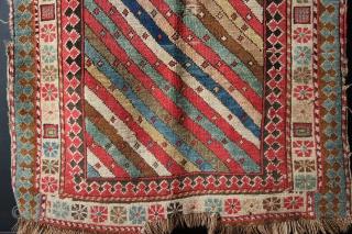 "Caucasian rug with diagonal stripes, circa 1850. 2'11"" x 5'5"""