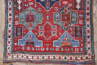 Antique Cloudband Kazak with single medallion. Great colours, good old one in useable condition but quite a lot of 'Granny stitch' has been done ie old homemade repair. See reverse pictures. On  ...