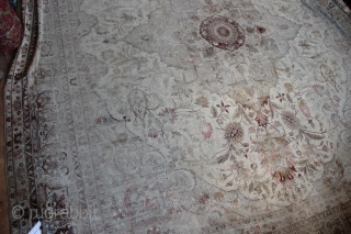 """Giant pale Amritsar carpet 590 x 525 or 19'6"""" x 16'10"""" Very worn allover,no actual holes. Fantastic 'look', with colours of cream, olive and deep magenta."""