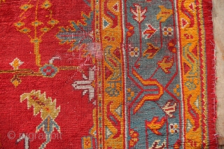 """19th century Oushak carpet 12'6"""" x 10'0"""" in good pile with a couple of worn spots and slightly ragged ends. Has been cleaned."""