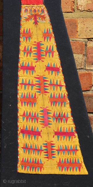 """Delightful Yellow silk Chyrpy sleeve fragment, mounted. Frame 13"""" (at widest point) x 38"""""""