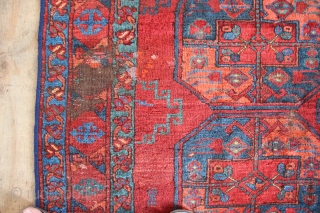 Richly coloured early 20th century Ersari carpet with shimmering wool. Nice mid blues, yellow and grass green. Sides reduced, kilims missing,many old reweaves and some wear, to the foundation in one place.  ...