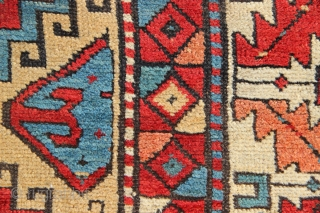 """Pretty South Caucasian long rug 4'0"""" x 9'2"""", nice yellow/camel field and interesting border change for no apparent reason. Some old repairs to edges, some wear but no holes."""