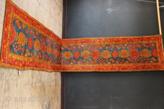 "19th century Oushak runner 3'8"" x 20'8"" cut and reduced at one end. Rather attractive greeny-blue field and in good condition with some low pile areas. Please look closely at the pictures.  ..."