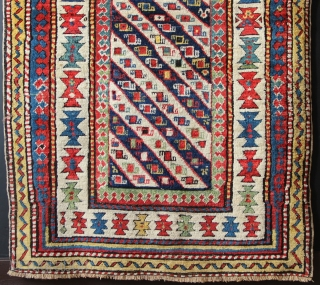"Late 19th century Caucasian long rug, with delightful, happy colours and good condition. Original sidecords, minor repiling. 3'7"" x 9'5"""