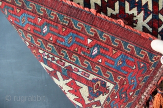 19th century fine Yomud asmalyk. Crisply drawn, with shimmering patina. The snowy white background shows off the mahogany brown/reds perfectly. The use of magenta silk and white cotton highlights indicates the weaver  ...