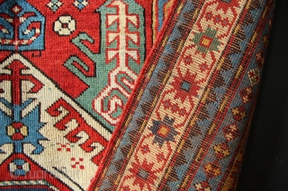 Unusually colourful Kasim Ushag Kazak with a somewhat ambitious date. A lovely, cheerful antique carpet that has had some professional repiling to the centre medallion and original ends and sides. 4' x  ...