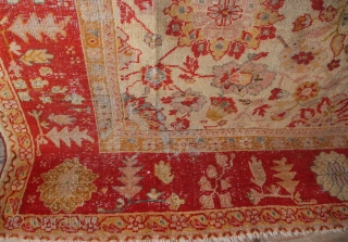 """19th century Ghiordes Oushak 292 x 390cm / 9'7"""" x 12'8"""". Unusually fine for this type. Very pale orange field, with pretty allover design. Worn areas and in need of cleaning. No  ..."""