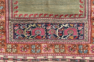 """Early 19th century Ghiordes prayer rug with beautiful abrashed green mihrab. Obvious damage to centre, otherwise even, low pile with original selvedges. 4'3"""" x 6'4"""""""