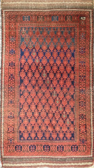 Very fine petite elegantly minimalist Timuri Baloch rug with 120 shrubs on a midnight blue field that shades to mid and light blue at the top.  Dated 1330 A.H. (1912).   ...