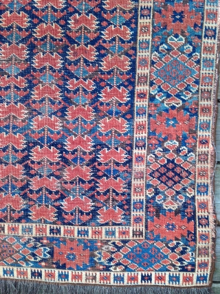 "19th century Beshir carpet, 7'6"" x 3'9"". Nine vertical stems with red blossoms on a field of dark and lighter blues.  Great colors. Mostly even low pile with heavy wear in  ..."