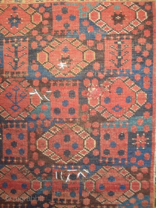 Antique Beshir Stacked Guls carpet, 130 x 186 cm. Heavy wear in places; small holes marked by white yarn. A rare mid-19th century Turkmen weaving with unusual design features and a wonderful  ...