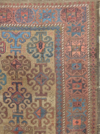 Symmetrically knotted Baluch with 43 Hooked motifs on Camel Field. 40 x 63 inches (102 x 170 cm) without kilim ends. Good condition, original goat hair side finish, end kilims rough. This  ...