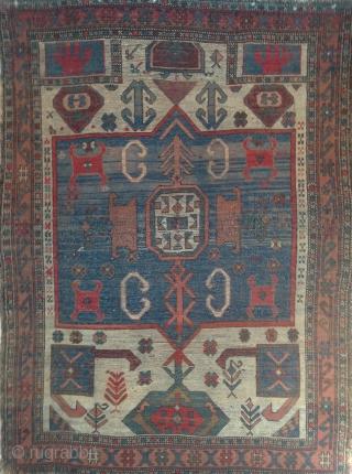 "Antique Kazak ivory field prayer rug, rare ""Markarian"" type, 3'9"" x 5'1"".  Original sides, no restorations. Mostly even wear, with heavier attrition near center where a 4-inch vertical slash has been  ..."