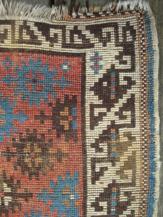 Antique Avar Daghistan small rug with 30 stars on tomato red field and dazzling broad ivory border. 32 x 52 inches. --Slight residue on back. --Price reduced.