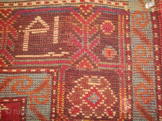 Inscribed small Karabagh rug, possibly Armenian, with unique field design that merits restoration. Heavy localized wear, a few small holes, original side finish. Excellent dyes.
