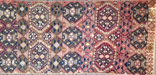"Anatolian kilim panel,2'8"" x 8'1"". Seven horizontal compartments containing 2 types of Guls. Unusual variety of materials: wool, goat hair, cotton, silk and metal-wrapped yarns. Very decorative early 20th century folk art  ..."