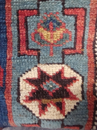 Rather unusual North East Caucasus Avar Medallion rug with light blue Octagon Gul centered in a red reserve surrounded by a deep blue field. Probably last quarter of 19th century. -- A  ...