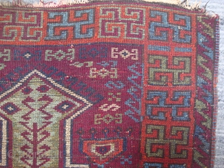 "East Anatolian prayer rug with rare ""Hittite Swastika Variant"" border. Circa late 19th century. Rough spots, incomplete edges reinforced with old kilim pieces sewn on verso."