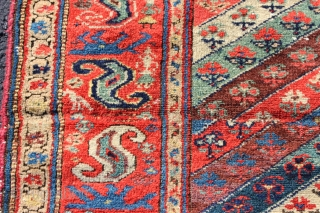 19th century Hamadan rug fragment.  Wool warp and good range of natural colors.  Cut and shut, patched and glue on back, but still great border and early example.