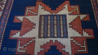 1900 Caucasian Kazak Leshgi Star.  48 x 78 inches.  Low even pile.  No damage or repairs.  Nice natural colors.