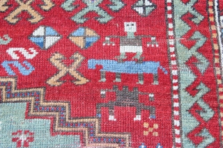 19th century Caucasian 5'2'' x 6'4''.  Estate found rug.  Some wear with small area of mothing, and several homemade repairs.  Sparing use of bright orange at one end.