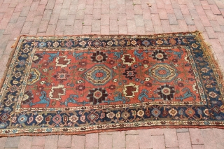 Mid 19th century or earlier Hamadan area village rug.  3'5'' x 6'9''.  Silky wool.  Original condition. Wool warp and weft. Interesting village interpretation of workshop carpets made around the  ...