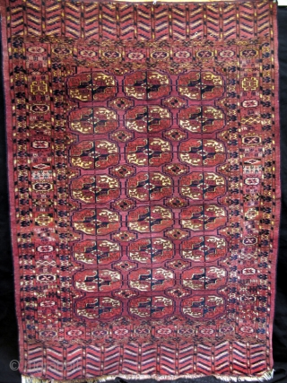 """Small Tekke rug from the turn of the 19th century withlively borders and nicely proportioned guls. (3'4"""" x 5'9"""" - Has glue on back.)"""