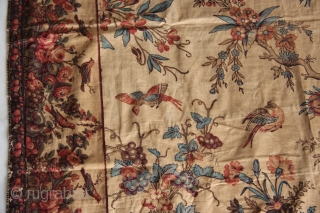An extremely rare large sized colourful Palampore block-print textile richly decorated with a tree bearing flowers and fruits, flanked by two smaller plants and surrounded by flowers, resting birds, birds in flight,  ...