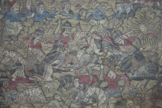 A beautiful Mughal-period Shield Cover richly decorated with war scenes all over, featuring soldiers fighting on foot and on horseback and courtiers. Thin golden metallic thread has been used all over.