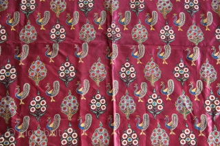 A lovely Mochi embroidery textile in maroon satin silk decorated in chain-stitch with peacock and floral motifs.