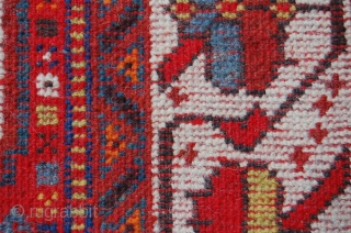 ANTIQUE TRIBAL QUASHGAI RUG (VERY PRETTY, RED WEFTED, FINE QUALITY, LOADS OF ANIMALS, AKSTAFA BIRDS/ HORSES). Size : 214 x 111 cm. Very good condition, medium pile allover with one lower area  ...