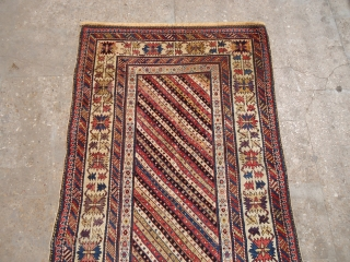 Colorful caucasian rug with beautiful design and very fine weave,all good colors,some old repairs done.E.mail for more info and pics.