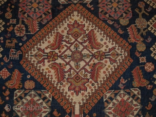 Antique Qashqai rug with triple medallion design, the medallions contain a large scale heratti design, this also has elements repeated in the field. 