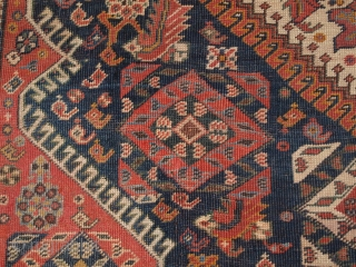 Antique Qashqai rug with triple medallion design, the medallions contain a large scale heratti design, this also has elements repeated in the field.   Circa 1900.  There are also many small birds, animals and  ...