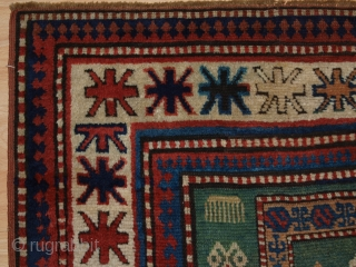 Antique Caucasian Karachov Kazak rug of compartment design on a rare green ground.