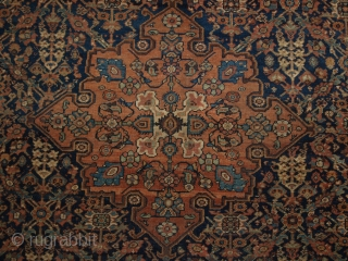 Antique Persian Faraghan rug of the garden shrub design with a single medallion.