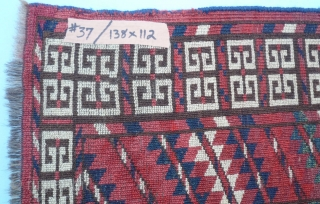 (37) Cherry-red Tekke Ensi (mihrab), 138 x 112, with a very cheery disposition. Plenty of turquoise and white as complimentary highlights, a close pile with very slight wear. Skirt is full of  ...